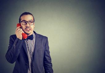 Worried man receiving bad news on phone