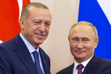 Russian President Putin and his Turkish counterpart Erdogan attend a news conference in Sochi