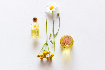 natural cosmetics from field flowers on white background closeup