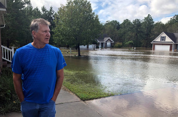 Gehring stands outside his home near flooded streets due to Hurricane Florence in Hope Mills