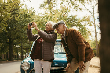 Senior couple on road trip taking pictures