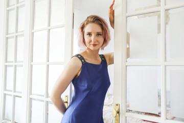 Fashion art portrait of beautiful woman at the window