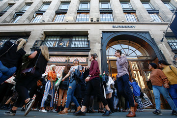 People queue outside a Burberry store on Regent Street, London