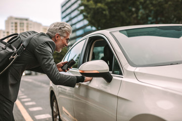 Man taking cab for traveling