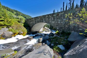 Stone Bridge Crosses Mountain Steam