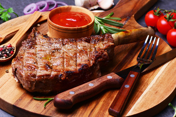 Tomahawk steak with spices and vegetables