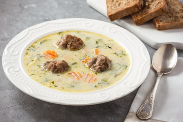 Creamy vegetable soup with beef meatballs.