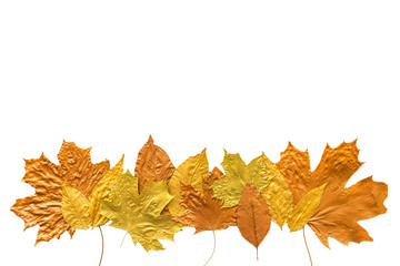Autumn metallic gold copper silver leaves isolated on white. Different fall metallic paint leaves border frame on white background with copy space. Horizontal mockup with autumn leaves
