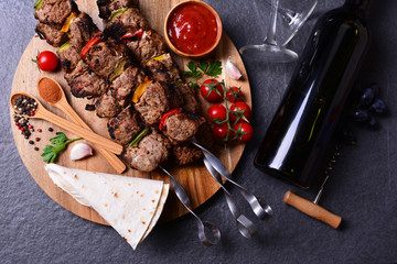 Kebab with wine spices and vegetables