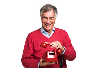 Man using a vintage phone