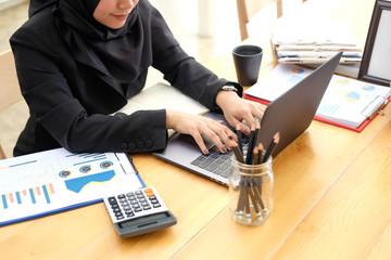 Islam woman working with laptop computer, Businesswoman working in office.