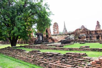 Pagoda and Buddha statues old at Wat Mahathat famous and popular tourist destinations Ayutthaya, Thailand.