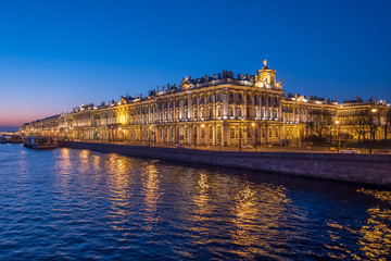 Night view of Hermitage palace and Neva river in Saint Petersburg, Russia.