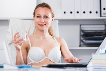 Woman working in bra at the laptop