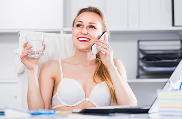 Portrait of smiling girl in underwear in the office