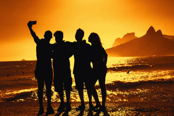Group of tourists taking selfie at beach at Rio de Janeiro