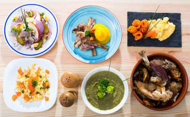 Dishes of traditional Norwegian cuisine with lamb rib, seafood and  vegetables