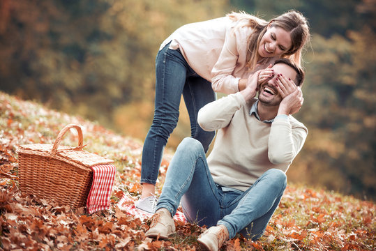 Couple on a picnic in autumn park
