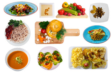 Many plates with different vegetarian food isolated on white background