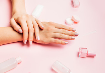Beautiful woman manicure on creative pink background. Minimalist trend.