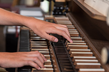 Person plays organ - close-up