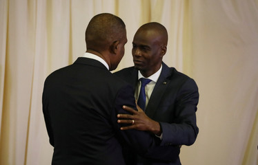 Haiti's PM Ceant embraces President Moise during the inauguration ceremony at the National Palace in Port-au-Prince