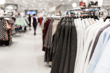 Women's coats on hangers in the store