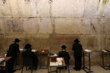 Jewish worshippers take part in Slichot, a prayer ahead of Yom Kippur , at the Western Wall in Jerusalem's Old City