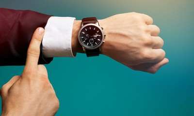 Businessman with hand watch on background, close-up