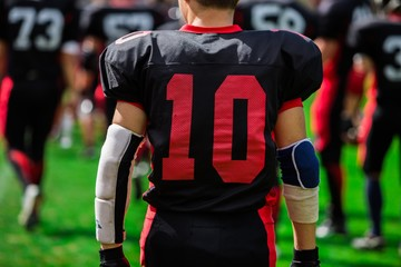 American Football Player With Teammates In Background Close-up