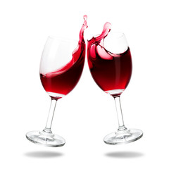 Cheers red wine with splash out of glass isolated on white background.