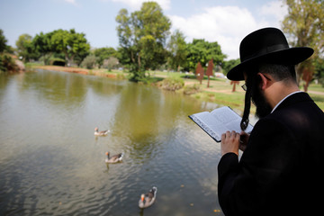 An ultra-Orthodox Jew takes part in the Tashlich ritual ahead of Yom Kippur in Ramat Gan, Israel