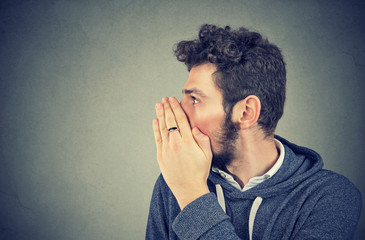 Man whispering private information a secret
