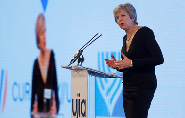 Britain's Prime Minister Theresa May speaks at the United Jewish Israel Appeal charity dinner in London