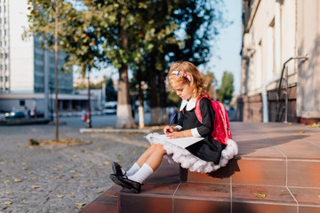 Drawing schoolgirl sitting on porch in autumn