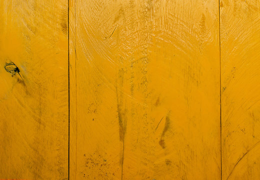 Yellow wood table background, lots of contrast, wooden texture