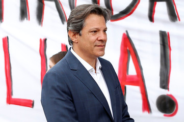 Workers Party presidential candidate Haddad leaves the Federal Police headquarters, where Brazilian former President Luiz Inacio Lula da Silva is imprisoned, after visiting him in Curitiba