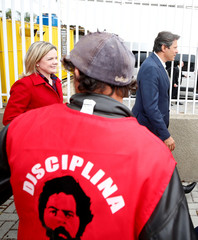 Workers Party Presidential candidate Haddad and Senator Hoffmann leave the Federal Police headquarters, where Brazilian former President Luiz Inacio Lula da Silva is imprisoned, after visiting him in Curitiba