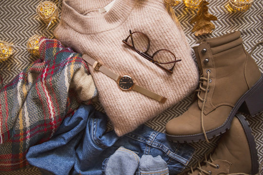 Autumn fashion clothing , outfit idea with sweater, boots and jeans