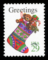UNITED STATES OF AMERICA - CIRCA 1980s: A greeting Christmas stamp printed in the USA shows stocking with gifts, circa 1980s