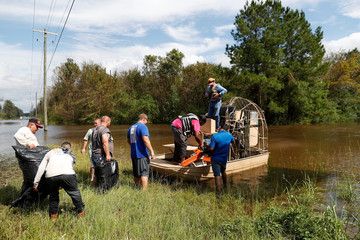 Members of the Cajun Navy transport loggers to clear power lines after Tropical Storm Florence caused a massive flooding in Whiteville