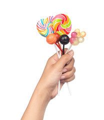 hand holding lollipops isolated on white background