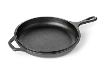 Empty, clean black cast iron pan or dutch oven over white