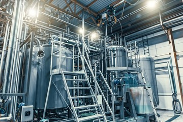 Modern brewery production steel tanks and pipes, machinery tools and vats, beer production