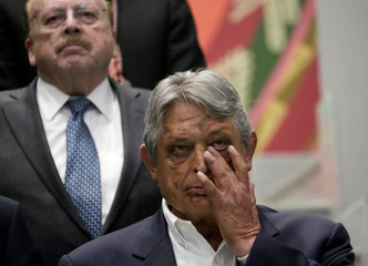 Bolivia's former President Jaime Paz Zamora and former Foreign Minister Carlos Iturralde attend a meeting at the presidential palace La Casa Grande del Pueblo in La Paz