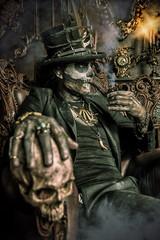 holding a skull