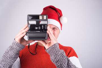 Santa-claus taking picture with his old camera
