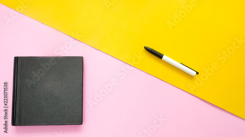 Wall mural black notebook with pen