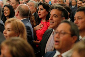 Audience members sing along to the U.S. national anthem at a Hispanic Heritage Month celebration at the White House in Washington