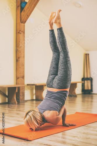 a9f512077a679 Woman doing yoga Vrschikasana/Scorpion pose.